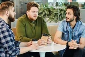 Three guys talking during their coffee break