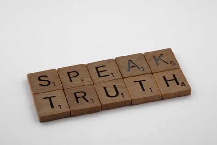 SPEAK TRUTH on scrabble pieces
