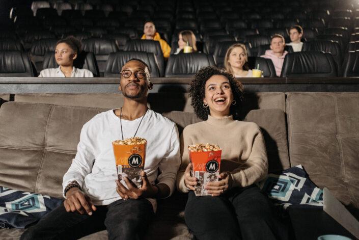 couple watching cinema enthusiastically