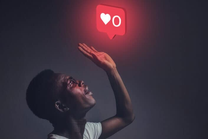 Man surprised by heart react red light