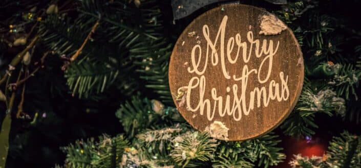 Merry Christmas Sign in a Christmas tree