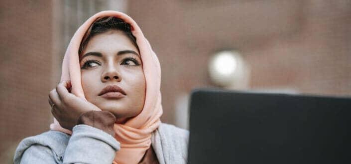 Muslim woman looking at something