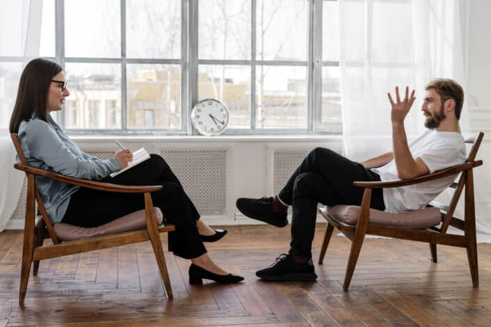 Man and woman casually talking