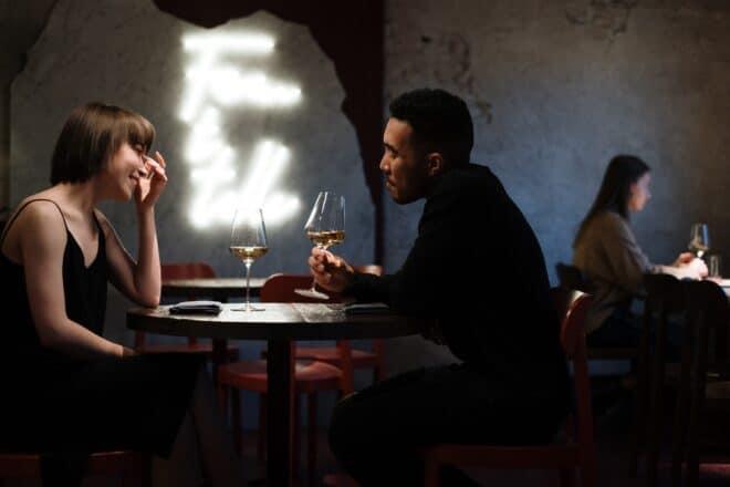 elegant couple drinking champagne - date night ideas
