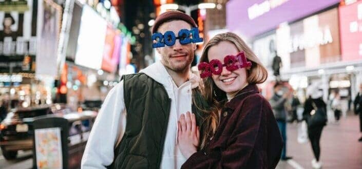 Couple posing while wearing 2021 glasses