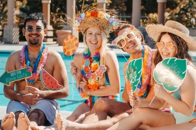 Questions to ask friends - Friends wearing a summer outfit beside a pool.