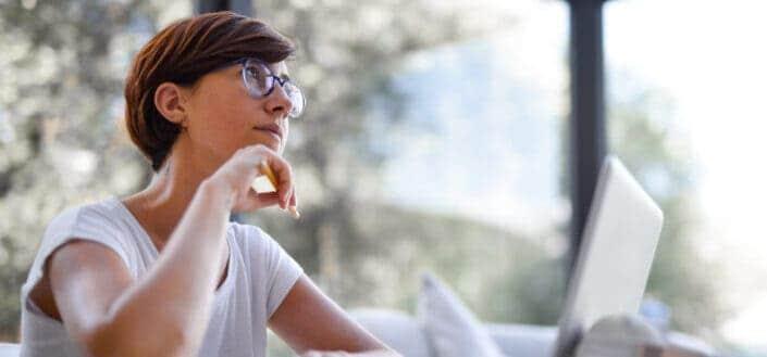Woman in eyeglasses thinking