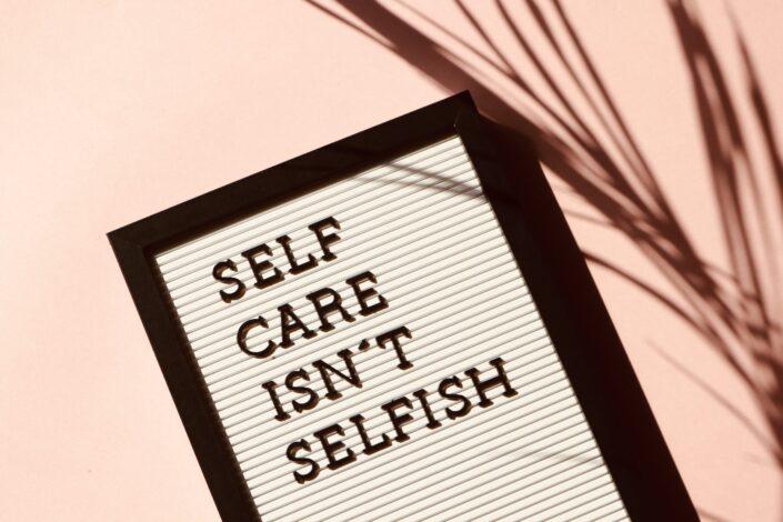 Words self care isn't selfish on frame