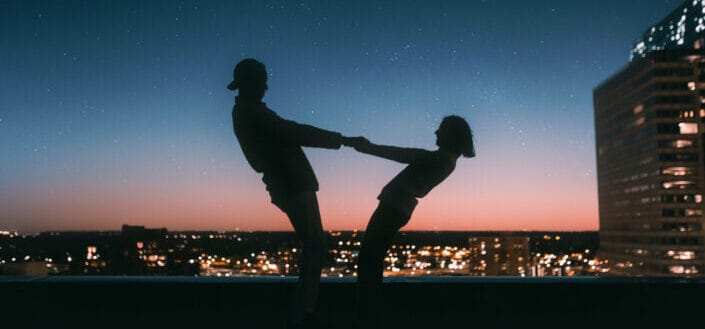 Silhouette of couple holding each other