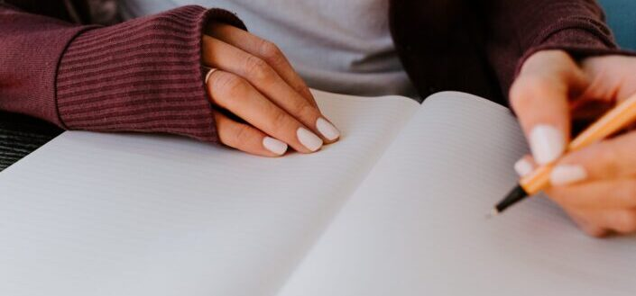 Young lady writing something on notebook