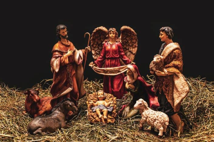 A nativity with the presence of an angel.