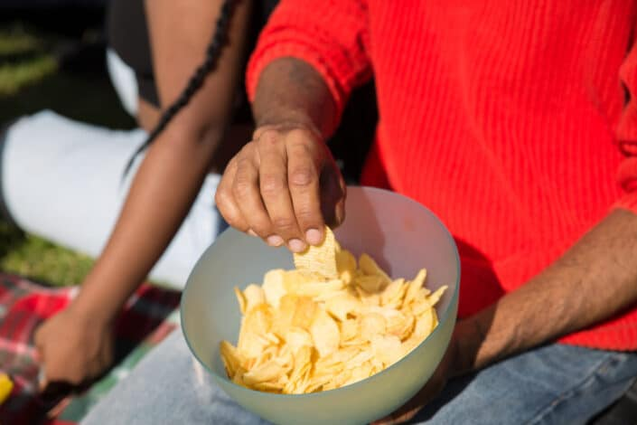 Man taking chips from a bowl