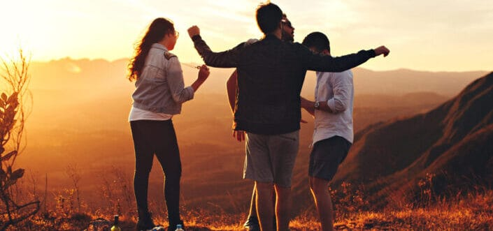 Friends having fun together at sunset