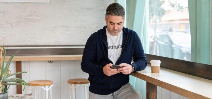 Man texting inside a coffee shop