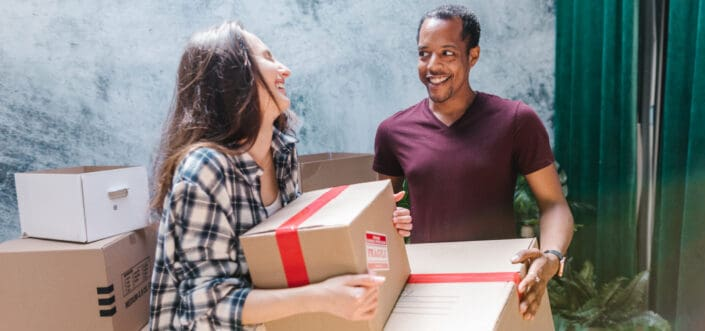 Man helping woman move out