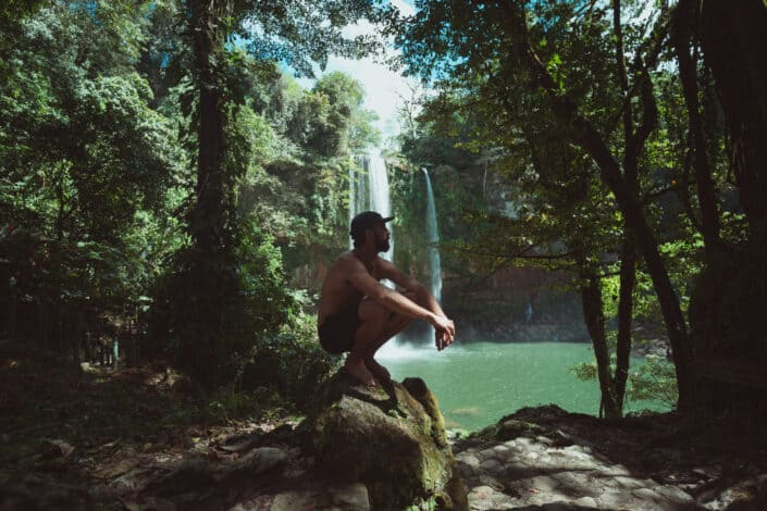 Man squatting while enjoying the view