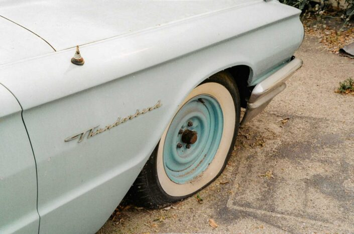 A vintage car with a flat tire