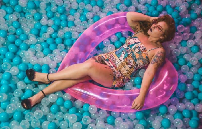 Woman lying on a pit of airballs