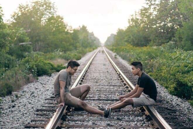two guys sitting on the rail track - weird questions to ask