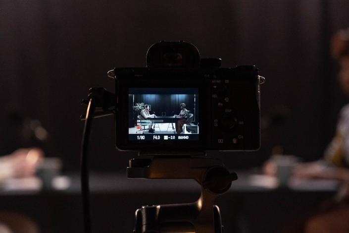 A camera recording a conversation