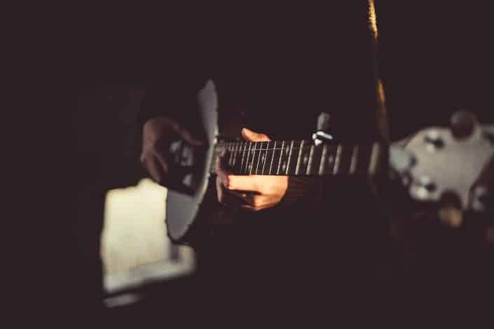A ukulele being played in the dark