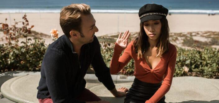 Woman gesturing a dislike towards a man