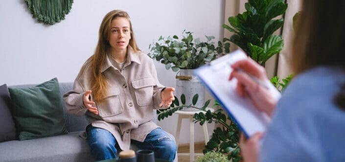 Woman answering to her interviewer