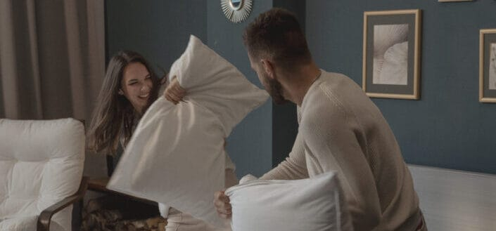 Couple playing a pillow fight