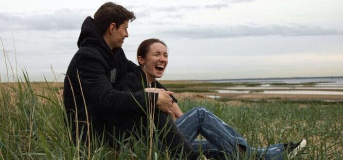 Couple dating outside while laughing
