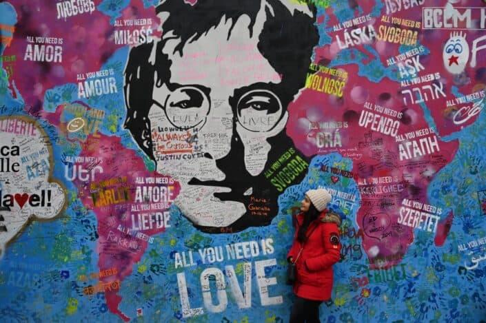 Woman mesmerizing the beatles street art