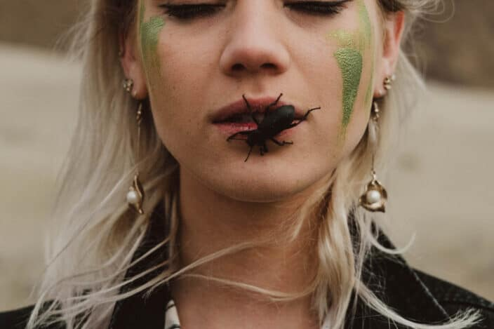 Uncommon photo of a woman with a bug on her mouth