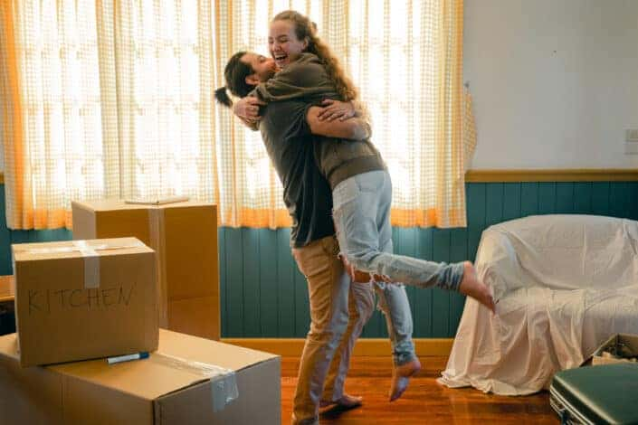man lifting his woman while moving out