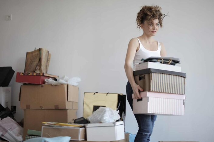 Woman busy packing up her things