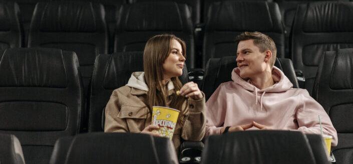 Happy couple inside movie theater