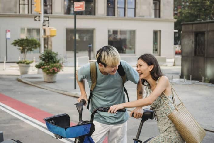 Man teaching his girl how to bike