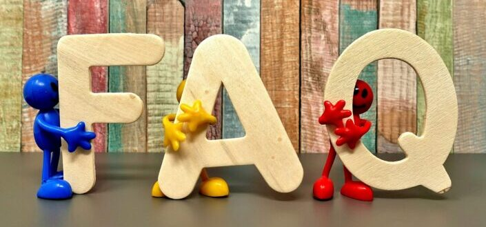 A wooden block of letters resembling FAQ