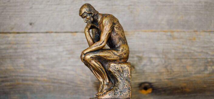 green ceramic statue of a man
