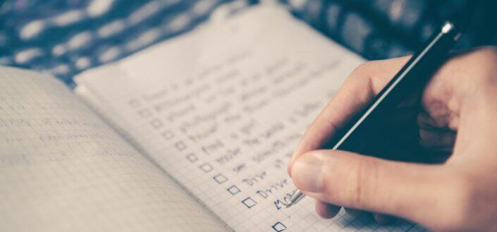 A checklist written on a notebook