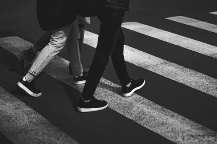 Men walking on a side walk
