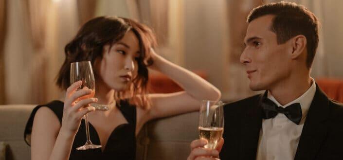 Couple in formal wear drinking champagne