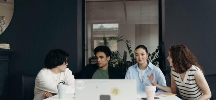 People having their meeting in their office.