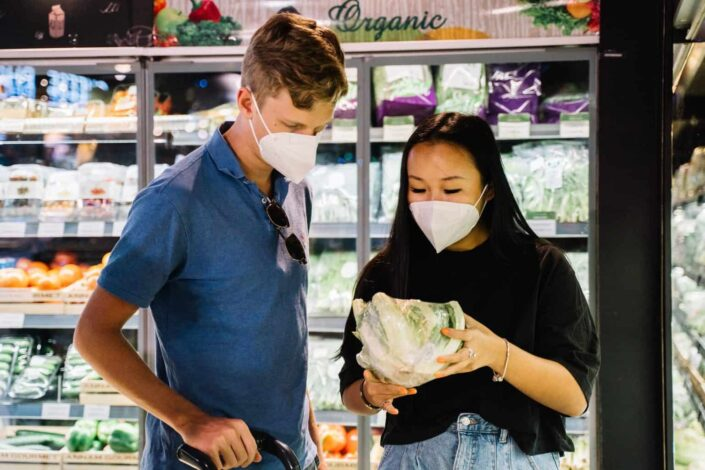 Couple looking at the vegetables quality