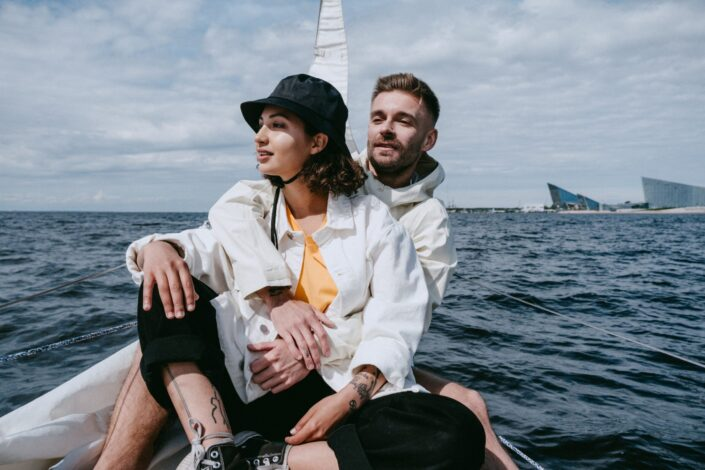 Couple riding boat in an ocean