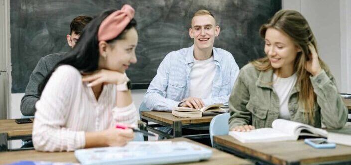 four people in a classroom