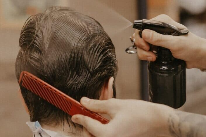 Man combing his customers hair