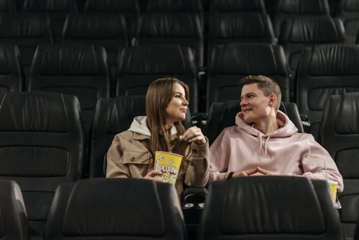 Couple staring at each other at movies