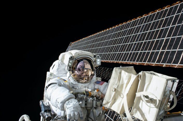 An astronaut in a satellite wings