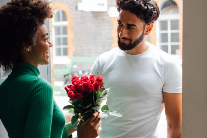 Man surprises his girl by giving flowers