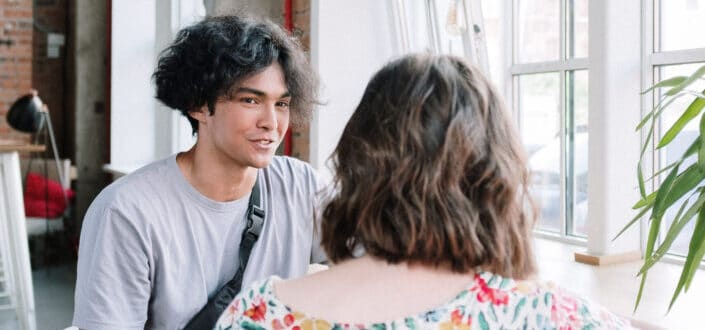 Young man talking to a girl