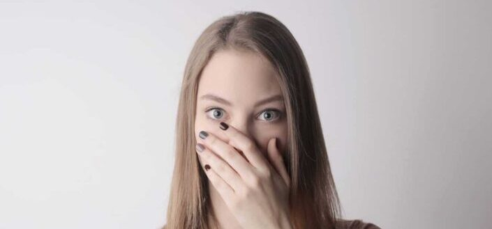 Shocked face woman with hand on her mouth